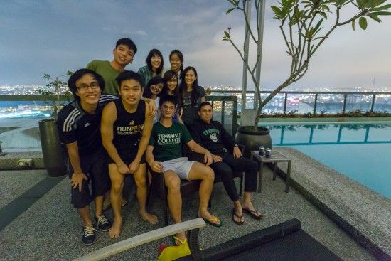 On the rooftop pool of our apartment in KL
